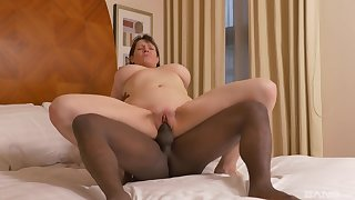 The lovely housewife works the black monster in both holes