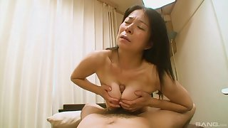 Hairy Japanese grandma Akiko Oda laying on their way back having sex