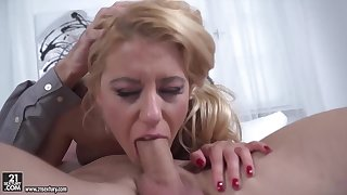 Delightful blonde in a floral dress, Nikky Thorne is vigorously sucking a huge cock, like a trull