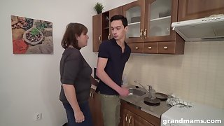 Sex-starved venerable landlady bangs young tenant right in the kitchenette